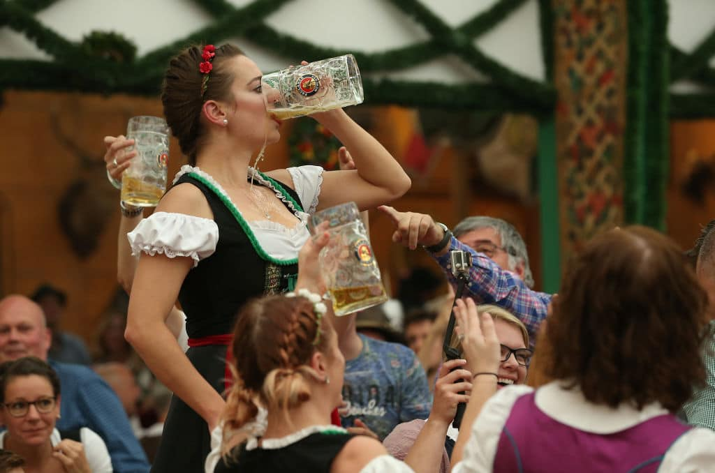 A female reveler from the USA downs her beer in the Armbrustschuetzenzelt tent on the second day of the 2018 Oktoberfest beer festival on September 23, 2018 in Munich, Germany. This year's Oktoberfest runs through October 7 and is the world's largest beer festival. Oktoberfest typically draws over six million visitors. (Photo by Sean Gallup/Getty Images)