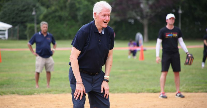 Bill Clinton umpires celebrity softball game days after Trump claimed he visited Epstein's 'Pedophile Island'
