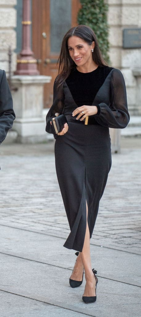 Meghan Markle was dressed in a long sleeved black dress by Givenchy, which featured a thigh-high slit and fitted bodice (Getty Images)