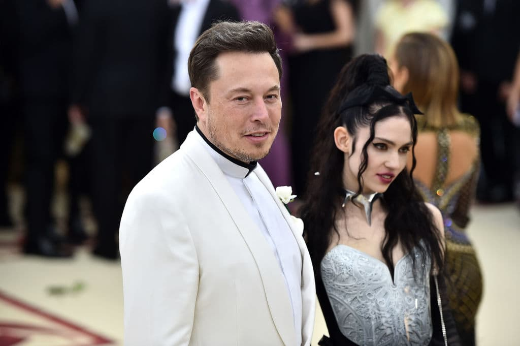 Elon Musk seen here with Grimes in New York May 7, 2018. SEC says that Musk chose the $420 price to impress his girlfriend, Montreal musician Grimes. The term '420' is commonly used to refer to marijuana (Getty Images)