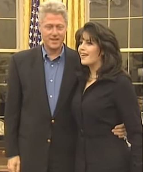 Once the photograph had been taken, he patted her on the back as she walked away (Clinton Library/YouTube)