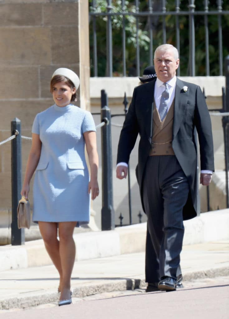 Princess Eugenie and with Prince Andrew at the wedding of Prince Harry and Meghan Markle at St George's Chapel, Windsor Castle on May 19, 2018 in Windsor (Photo by Chris Jackson/Getty Images)