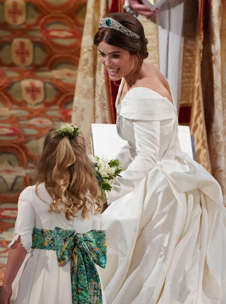 Princess Eugenie passes her bouquet to bridesmaid Savannah Phillips during her wedding to Jack Brooksbank at St. George's Chapel on October 12, 2018 in Windsor, England. (Photo by - WPA Pool/Getty Images)