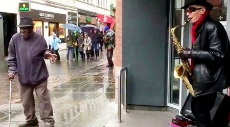 Disabled man ditches walking stick and breaks into dance after spotting a groovy busker