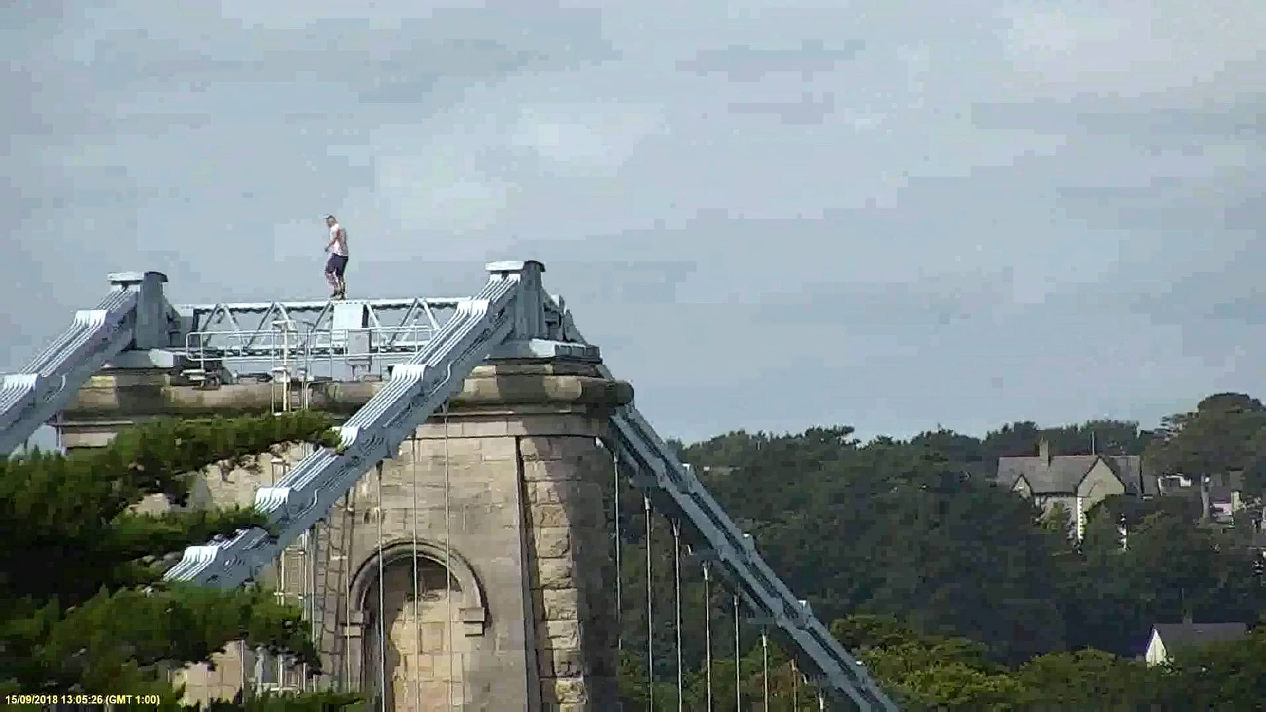 The man remained at the top of the bridge for an hour (SWNS)