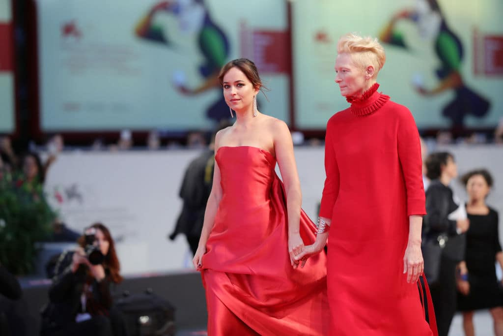 Dakota Johnson and Tilda Swinton walk the red carpet ahead of the 'Suspiria' screening during the 75th Venice Film Festival at Sala Grande on September 1, 2018, in Venice, Italy. (Getty Images)