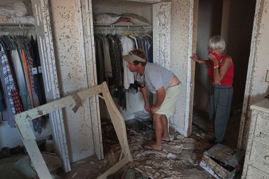 John McClenny helps LeClaire Bryan, mother of country music artist Luke Bryan, recover items from her home after it was severely damaged by Hurricane Michael on October 19, 2018 in Mexico Beach, Florida. Hurricane Michael slammed into the Florida Panhandle on October 10, as a category 4 storm causing massive damage and claiming over 30 lives. (Photo by Scott Olson/Getty Images)