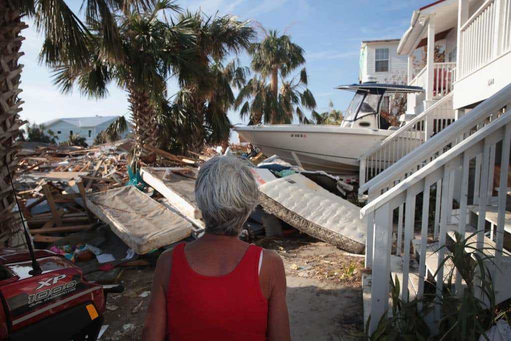 LeClaire Bryan, mother of country music artist Luke Bryan, looks over debris piled near her home by Hurricane Michael on October 19, 2018 in Mexico Beach, Florida.  (Photo by Scott Olson/Getty Images)