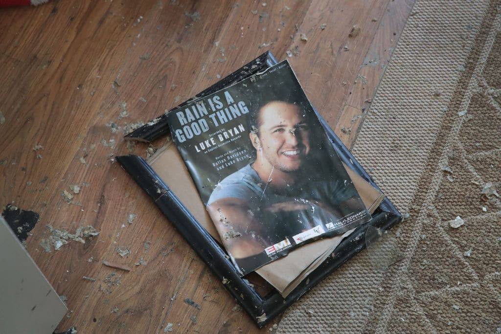 A framed momento from her son's music career lays broken on the floor of the home of LeClaire Bryan in Mexico Beach, Florida (Photo by Scott Olson/Getty Images)