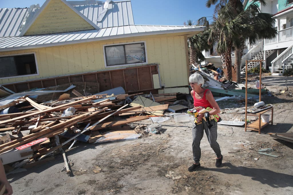 LeClaire Bryan recovers items from her home after it was severely damaged by Hurricane Michael on October 19, 2018 in Mexico Beach, Florida. (Photo by Scott Olson/Getty Images)