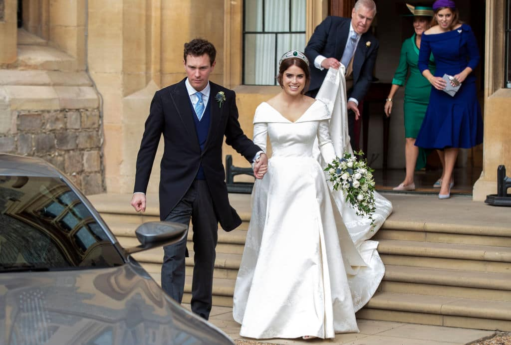 Princess Eugenie and Jack Brooksbank helped by Princess Beatrice and Prince Andrew, Duke of York leave Windsor Castle in an Aston Martin DB10 after their wedding for an evening reception at Royal Lodge on October 12, 2018 in Windsor, England (Getty Images)