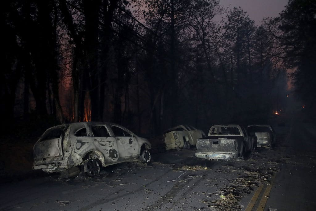 Abandoned burned out cars sit in the middle of the road after the Camp Fire moved through the area on November 8, 2018 in Paradise, California (Getty Images)
