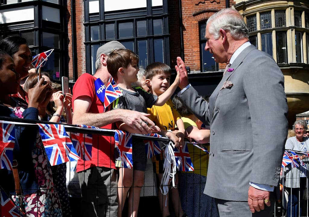 Prince Charles, Prince of Wales 'high-fives' a boy as he meets well-wishers during the royal visit to Salisbury on June 22, 2018, in Salisbury, United Kingdom. (Getty Images)