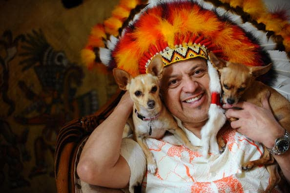Paul Rodriguez poses with his dogs Chica and Moska during a portrait session on March 2, 2010, in Los Angeles, California. (Photo by Michael Caulfield/Getty Images)