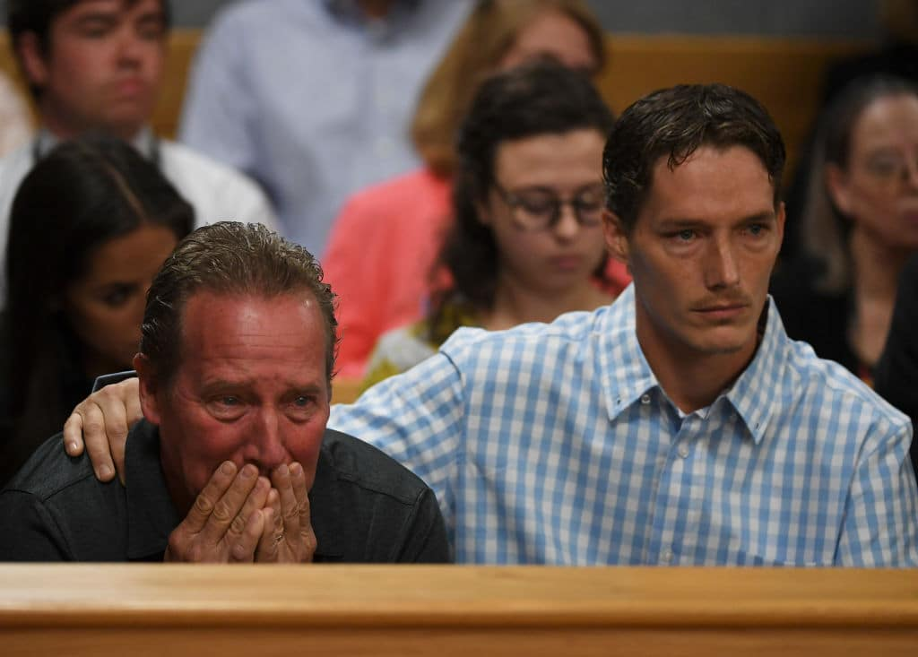 Shanann Watts' father Frank Rzucek (left) and brother Frankie Rzucek break down at the Weld County Courthouse on August 21, 2018 in Greeley, Colorado. (Photo by RJ Sangosti - Pool/Getty Images)