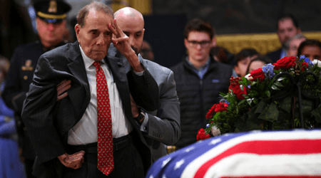 Former senator Bob Dole, 95, rises from his wheelchair for one final emotional salute to George HW Bush
