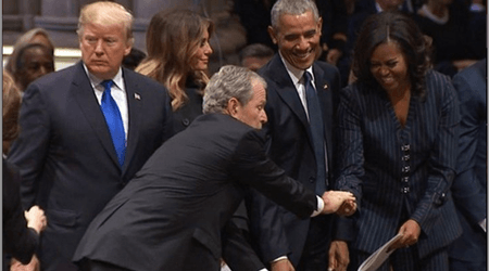 George W Bush slips Michelle Obama a mint during his father's funeral mirroring the famous candy exchange at McCain's funeral