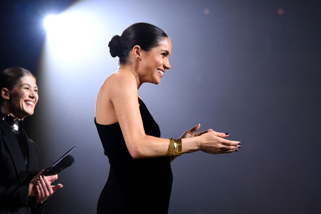 Meghan Markle is being criticized for touching her baby bump too much (Getty Images)