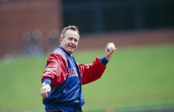 George H.W. Bush throws out the first pitch before the Texas Rangers Opening Day game against the Chicago White Sox at The Ballpark in Arlington on April 3, 2000, in Arlington, Texas (Getty Images)