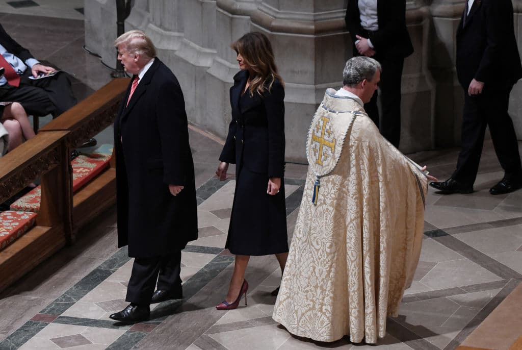 Donald Trump and first lady Melania Trump attend Christmas Eve services at the National Cathedral on December 24, 2018 in Washington, D.C. (Photo by Olivier Douliery - Pool/Getty Images)