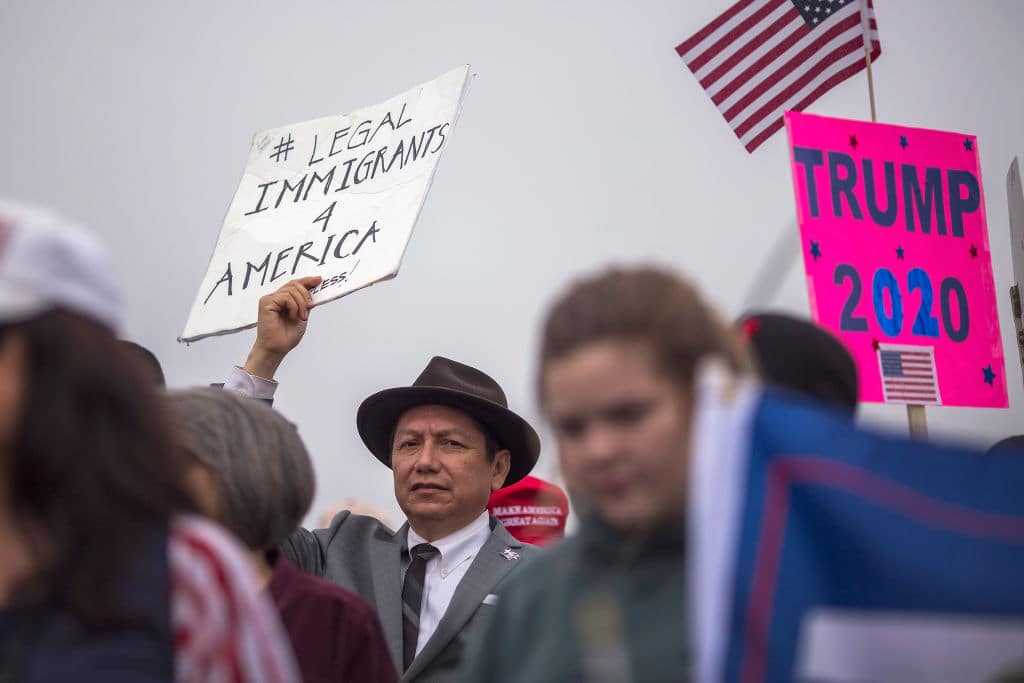 Supporters of U.S. President Donald Trump rally for the president during his visit to see the controversial border wall prototypes on March 13, 2018 in San Diego, California. (Getty Images)