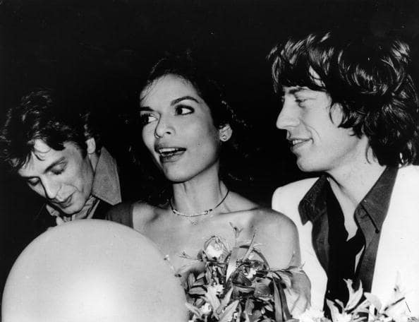 Dancer Mikhail Baryshnikov, Bianca Jagger, and her husband the singer Mick Jagger, party at Studio 54 for Bianca's birthday, May 1977. (Photo by Rose Hartman/Getty Images)