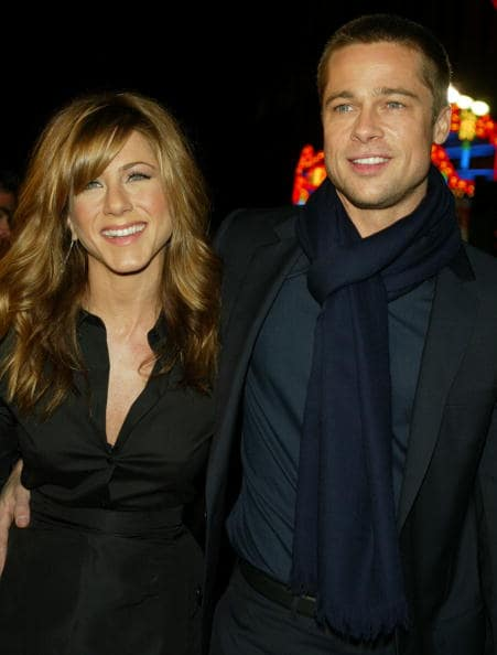 Actress Jennifer Aniston and actor Brad Pitt attend the Los Angeles premiere of Universal Pictures' film 'Along Came Polly' in January 12, 2004 in Hollywood, California. (Photo by Kevin Winter/Getty Images)