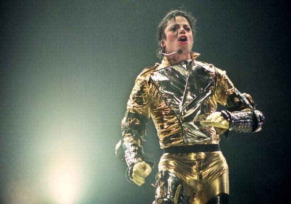 Michael Jackson performs onstage during the 'HIStory' world tour concert at Ericsson Stadium on November 10, 1996, in Auckland, New Zealand. (Photo by Phil Walter/Getty Images)