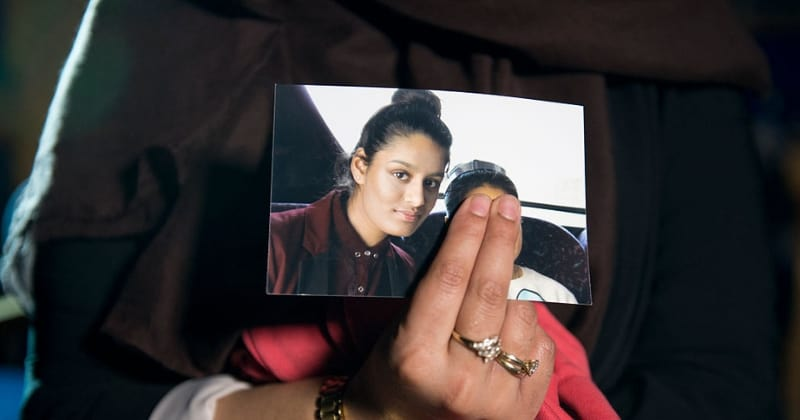 Renu Begum, eldest sister of Shamima Begum, holds her sister's photo as she is interviewed by the media at New Scotland Yard (Getty Images)