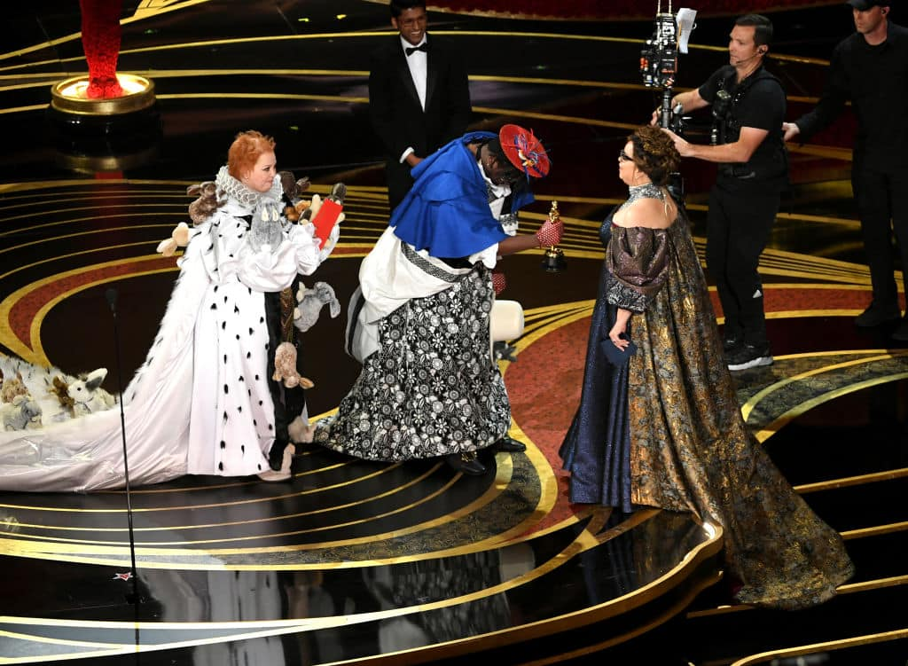 (L-R) Melissa McCarthy and Brian Tyree Henry present the Costume Design award for 'Black Panther' to Ruth E. Carter onstage during the 91st Annual Academy Awards at Dolby Theatre on February 24, 2019 in Hollywood, California. (Photo by Kevin Winter/Getty Images)
