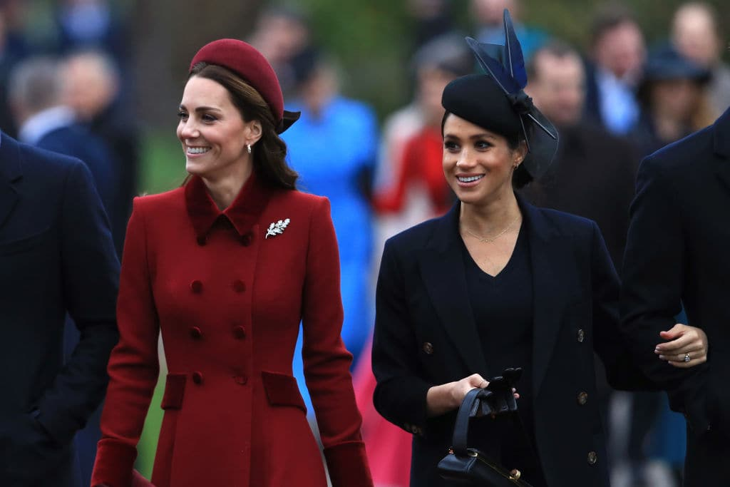 Catherine, Duchess of Cambridge and Meghan, Duchess of Sussex arrive to attend Christmas Day Church service at Church of St Mary Magdalene on the Sandringham estate on December 25, 2018 in King's Lynn, England. (Photo by Stephen Pond/Getty Images)