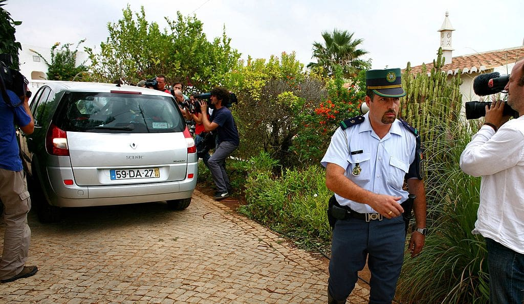 Media surround the McCann family car as it leaves the apartment in Praia da Luz with the twins September 8, 2007 in the Algarve, Portugal (Getty Images)