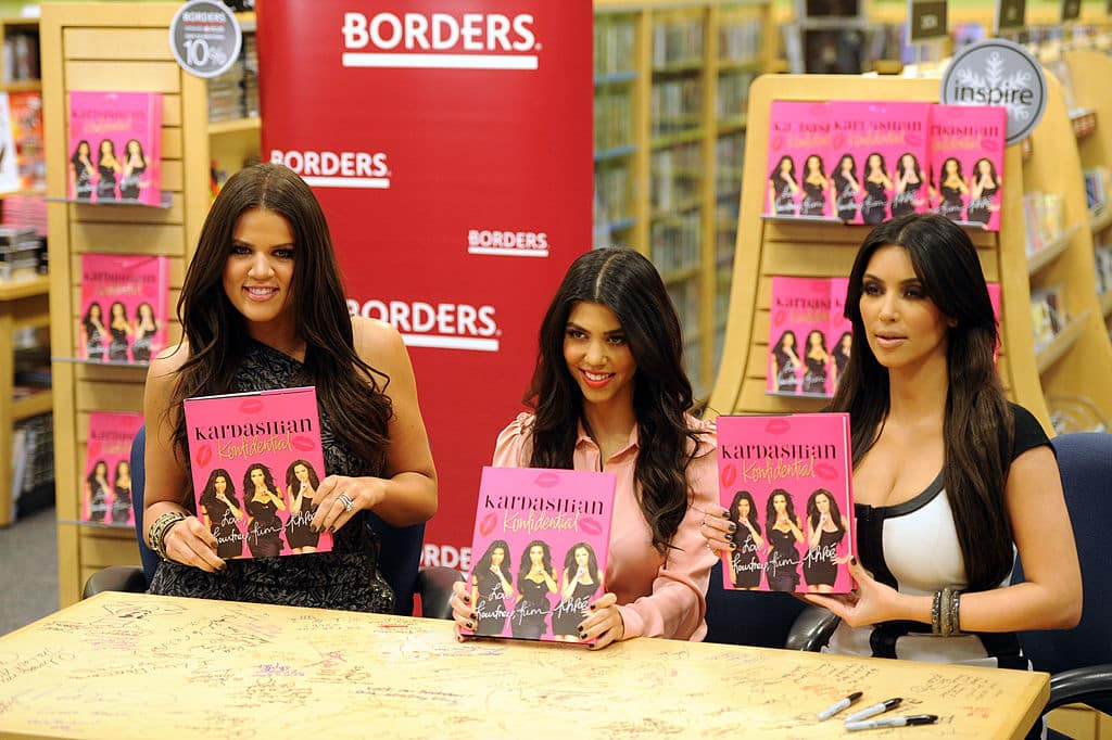 (L-R) Television Personalities Khloe Kardashian, Kourtney Kardashian and Kim Kardashian make an appearance at Borders Century City to sign copies of their book 'Kardashian Konfidential' on December 2, 2010 in Los Angeles, California. (Photo by Frazer Harrison/Getty Images)