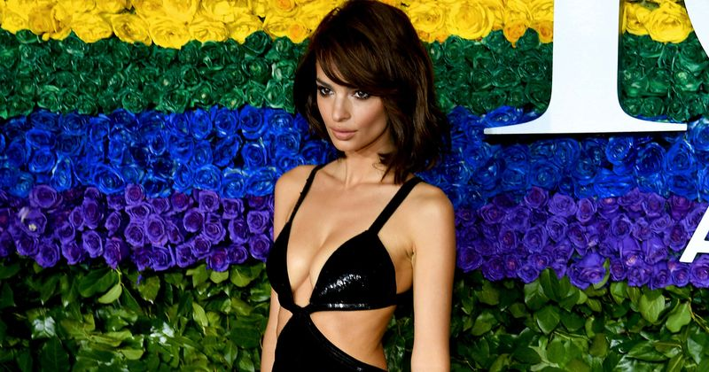 Emily Ratajkowski goes completely nude as she poses by her apartment window during coronavirus lockdown