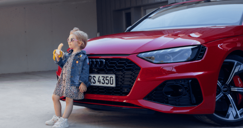 Audi pulls 'suggestive' ad showing girl eating a banana in front of car amid outrage: 'We care for children'