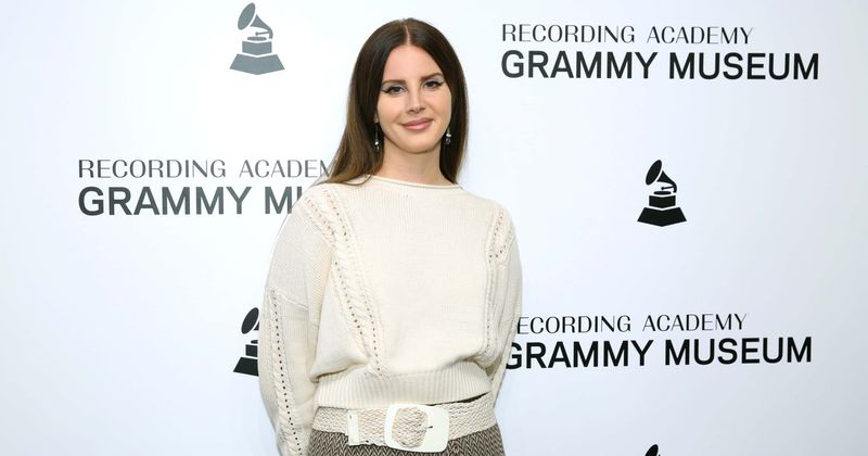 Lana Del Rey sizzles in plunging yellow top as she teases single 'Tulsa Jesus Freak' from upcoming album