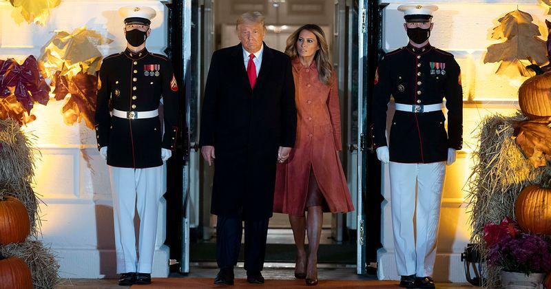 Melania rocks rust coat hosting White House Halloween event with Trump, Internet says 'she's as orange as him'